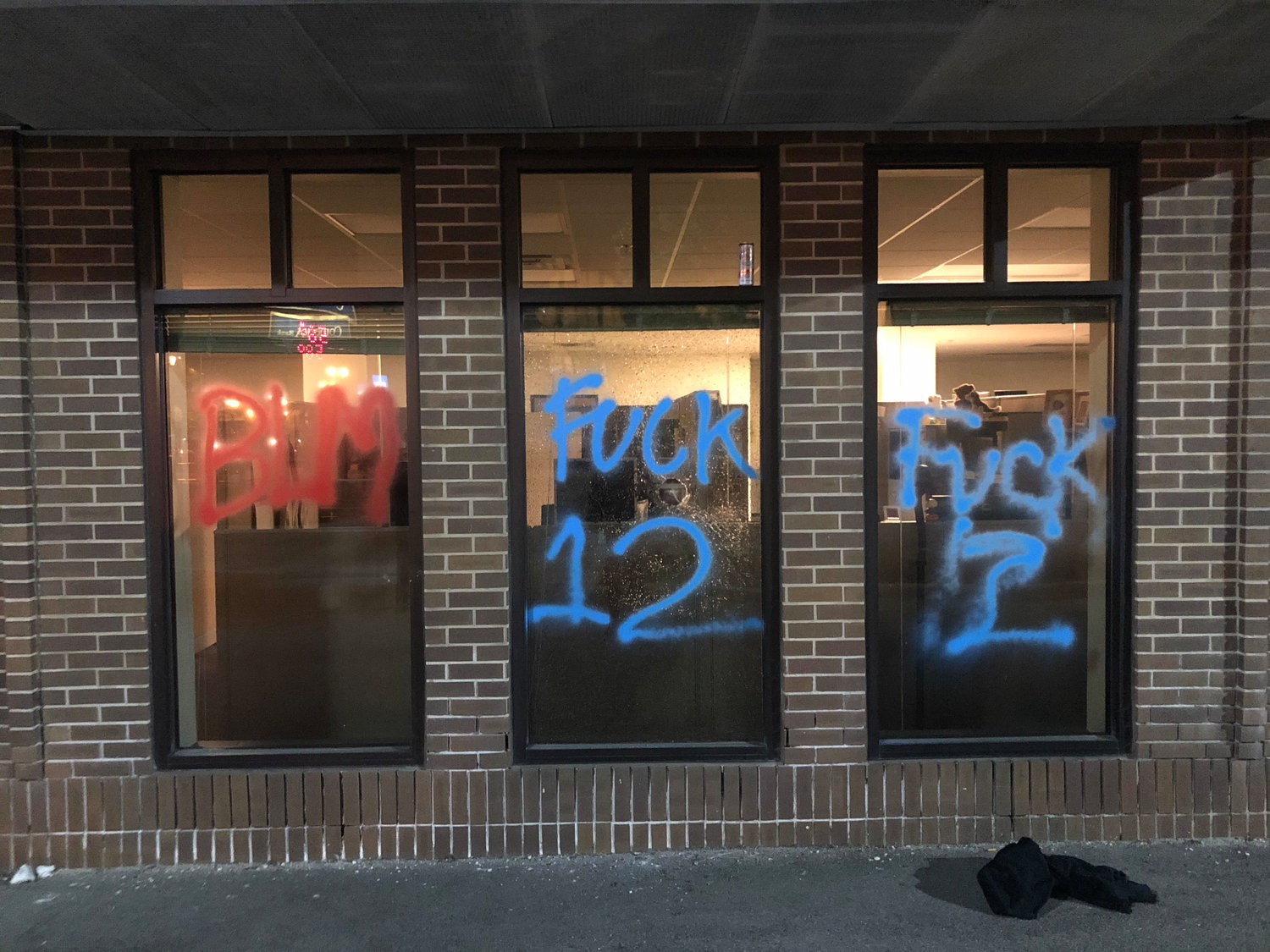 "Graffiti in downtown Lansing reading ""BLM"" and ""Fuck 12."""