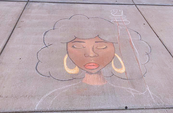 Naviah Reyna's unfinished chalk drawing that was interrupted by Lansing police officers. She and many other artists will have artwork on display at Art at the Capitol this Saturday.