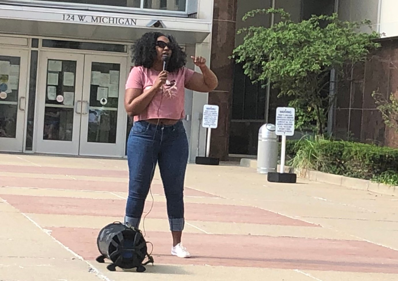 Natasha Atkinson, speaking here at a Black Lives Matter rally in front of City Hall in Lansing, was fired from the Mayor's Office in February, even though there is no written record of performance issues.