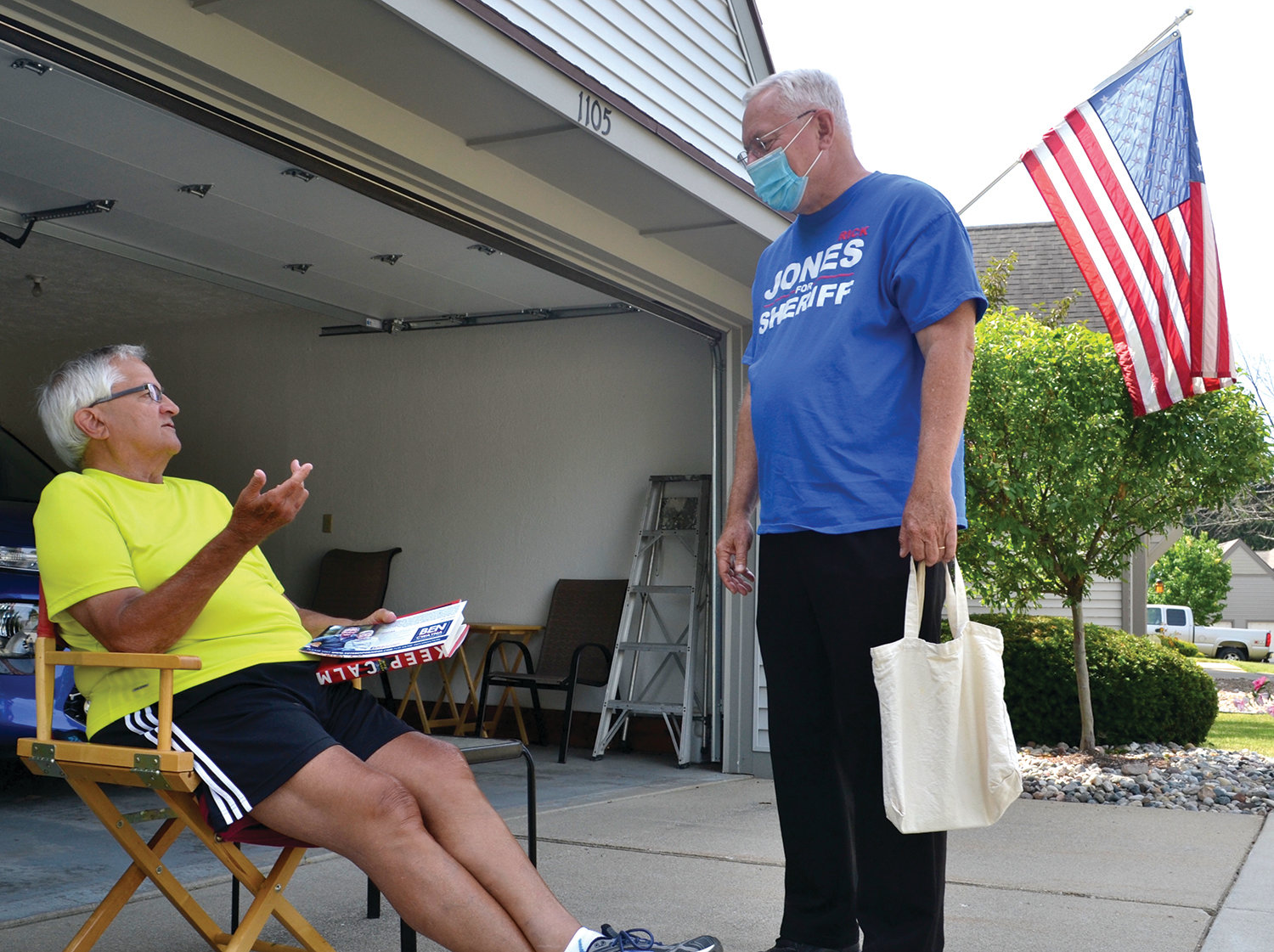 Rick Jones speaks with voter Jim Smith at his home on Gull Street.
