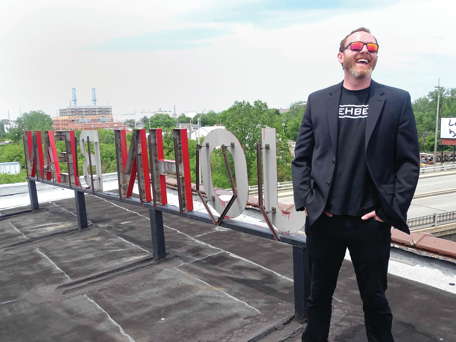 Michael Doherty, founder of Rehbel Industries, on the roof of the old John Bean Building, on South Cedar Street, which he is in the process of converting into one of the largest marijuana growing operations in the world.