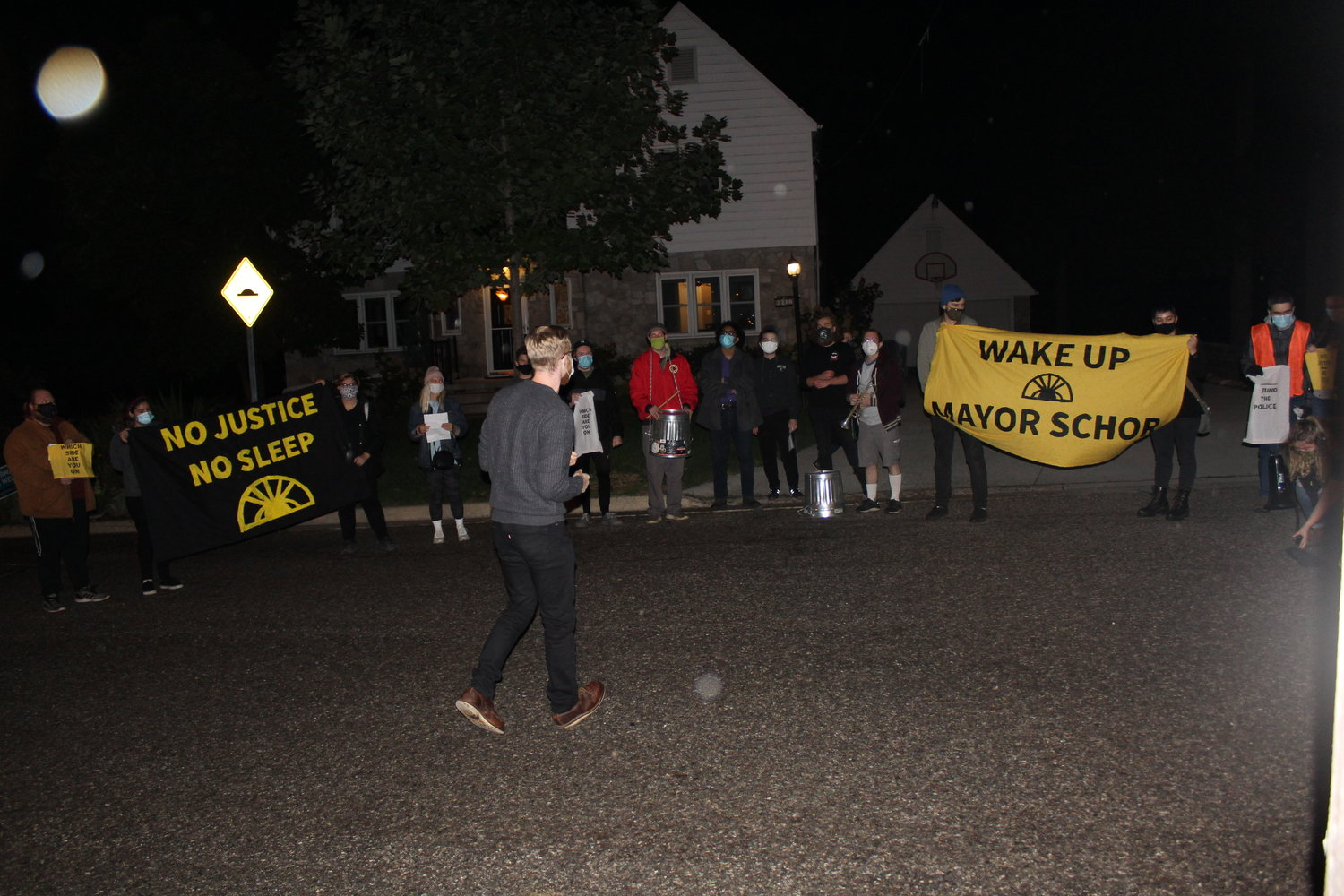 Protesters in front of Lansing Mayor Andy Schor's house last night demanding the mayor defund the police or resign.