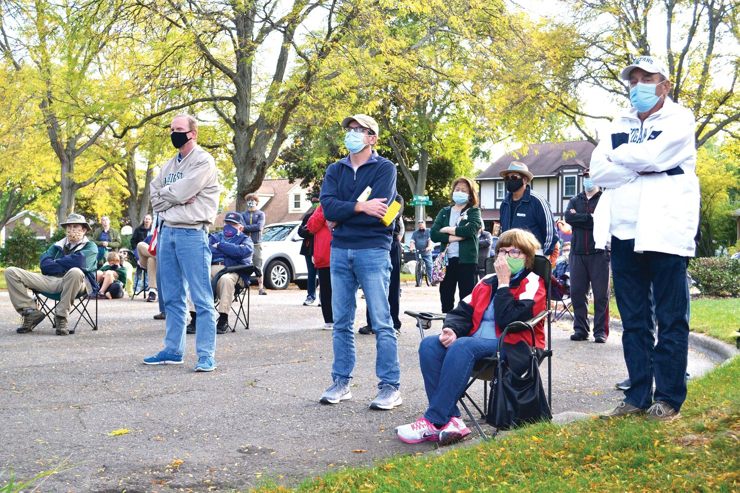 Neighbors gather Tuesday evening on Hillgate Circle in northeast Lansing for a meeting with city officials over steep assessments they face for the anti-pollution Montgomery Drain project.