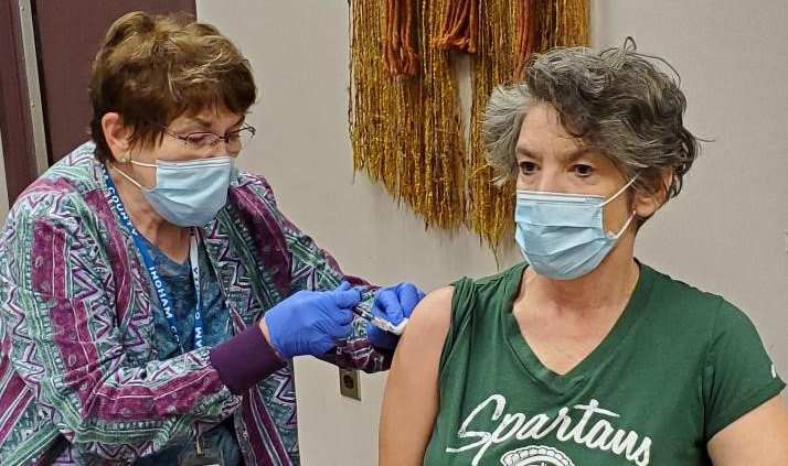 Ingham County Health Officer Linda Vail receives a vaccine ahead of this year's flu season.
