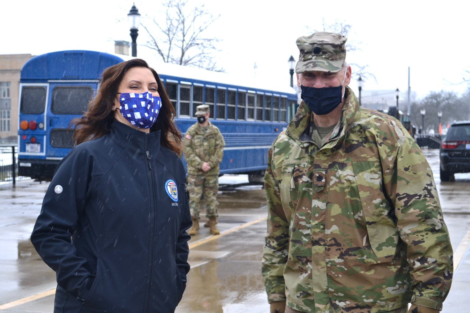 Gov. Gretchen Whitmer shares a laugh with a member of the National Guard.