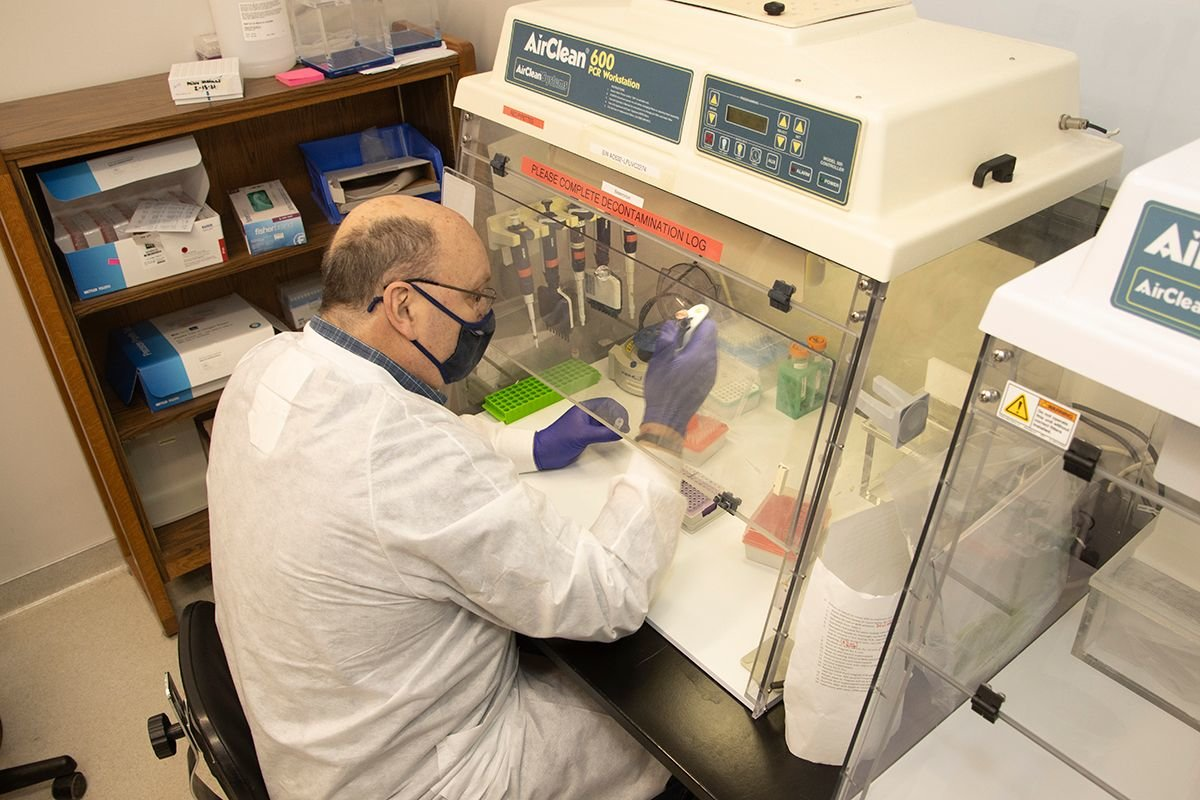 Steve Dietrich performs sample preparation for genome sequencing of SARS-CoV-2.