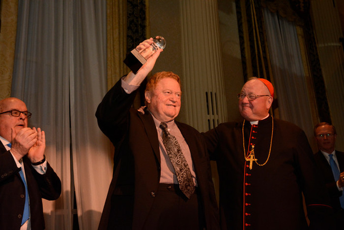 Former New York Mets star Rusty Staub receives the Terence Cardinal Cooke Humanitarian Award on June 9 from Cardinal Dolan at the 80th annual CYO Club of Champions Tribute Dinner at the Waldorf Astoria in Manhattan.