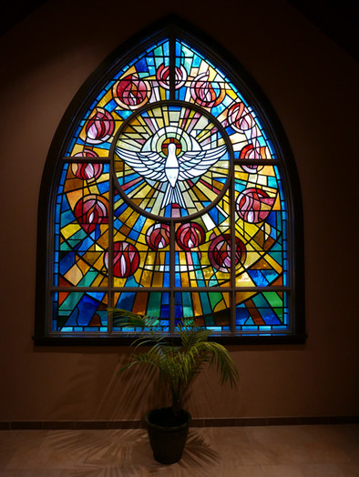A stained-glass window at Holy Spirit parish in Cortlandt Manor depicts a dove, a symbol of the church's namesake. The image was used on prayer cards in celebration of the parish's 50th anniversary.