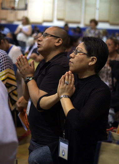 Attendees of the New York Catholic Bible Summit join in fervent prayer.