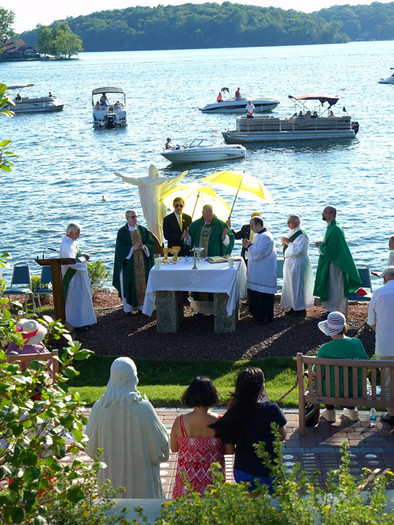 Cardinal Dolan celebrates an outdoor Mass on June 18 at St. John the Evangelist's lakefront property in Mahopac. The cardinal dedicated and blessed the parish's Prayer Garden of Remembrance, which opened last year. A live screening of the Mass was shown inside the parish chapel.