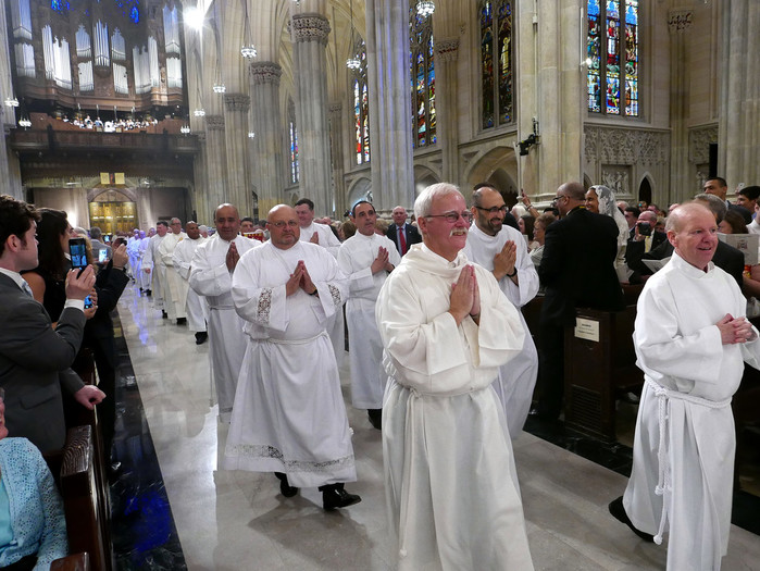 ORDINATION AWAITS—Deacon Robert Cranston and Deacon Michael Hall lead the procession at the Mass of Ordination in St. Patrick's Cathedral on June 25 for the 12 men who were ordained to serve as permanent deacons in the archdiocese.