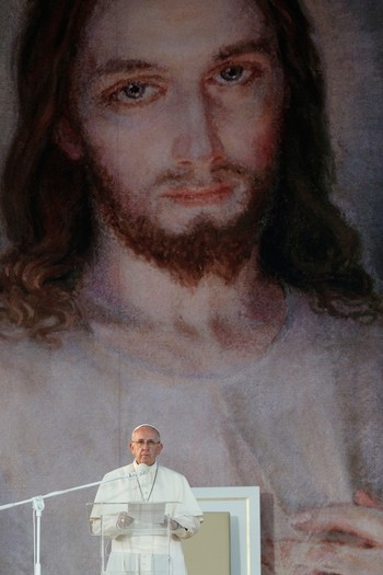 An image of the Sacred Heart of Jesus forms the backdrop as Pope Francis gives a reflection during the Way of the Cross at World Youth Day in Blonia Park in Krakow, Poland, July 29. Throughout the weeklong youth gathering, the Holy Father stressed the importance of developing a close relationship with Jesus.