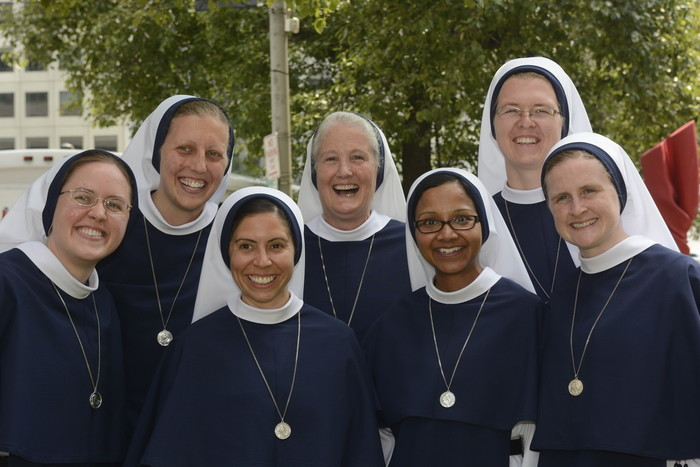 Six Sisters of Life, following their profession of final vows, celebrate with the order's superior general, Mother Agnes Mary Donovan, S.V.  They are, from far left, front row: Sister Ann Catherine, S.V., Sister Maria Laetitia, S.V., Sister Grace Dominic, S.V. and Sister Maeve Nativitas, S.V. Back row, from left: Sister Brigid Ancilla Marie, S.V., Mother Agnes Mary, S.V. and Sister Maria Emmanuel, S.V.