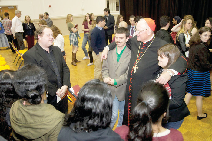 Cardinal Dolan poses for a photo with students following his talk on mercy and joy at SUNY New Paltz's Student Union Center on Oct. 5. Some 150 people attended the talk including students from SUNY New Paltz, Marist College, Mount St. Mary College, Vassar College and Rockland Community College.