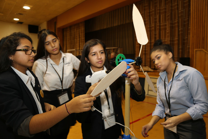 Jarlene Gonzalez, Chelsea Rivera, Brianna Grullon and Karina Garcia, all from Cathedral High School, observe a wind turbine at the 'Engineering Tomorrow' conference at Cathedral High School in Manhattan Dec. 2