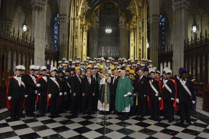 Fourth-degree Knights of Columbus and state officials of the Catholic fraternal organization join Cardinal Dolan, honorary state chaplain, and Father Brian McWeeney, an archdiocesan priest who is senior associate state chaplain, in the sanctuary of St. Patrick's Cathedral after the annual Respect Life Mass Jan. 22.