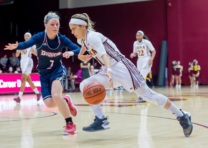 Iona College's Marina Lizarazu dribbles past a Duquesne defender during a home game in New Rochelle. The senior point guard was voted the Metro Atlantic Athletic Conference's Preseason Player of the Year.