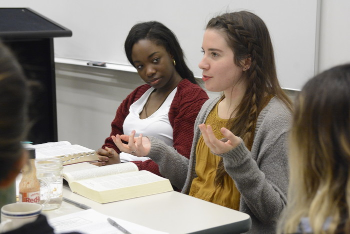 New York University student Lyn Brumaire, at left, attends a women's Bible study hosted by FOCUS missionary Nicole Michell, right, in NYU's Catholic Center in Manhattan Feb. 21.