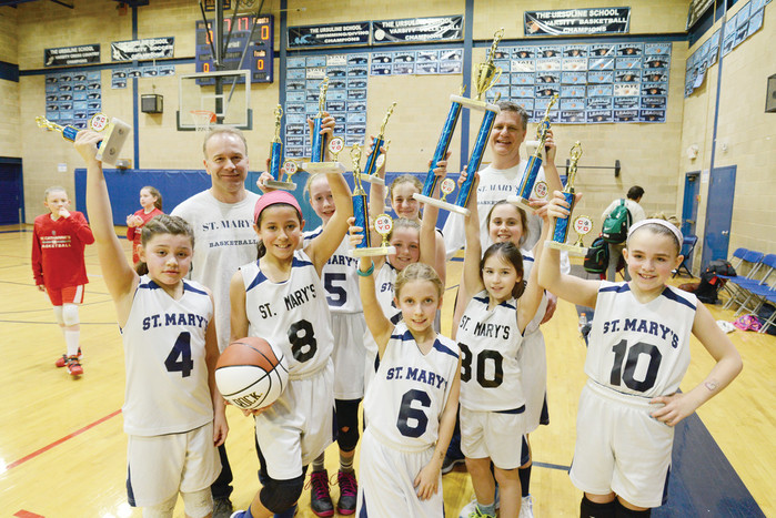 Players and coaches from St. Mary of the Assumption, Katonah, celebrate winning the fourth-grade CYO archdiocesan basketball championship at The Ursuline School in New Rochelle March 19.