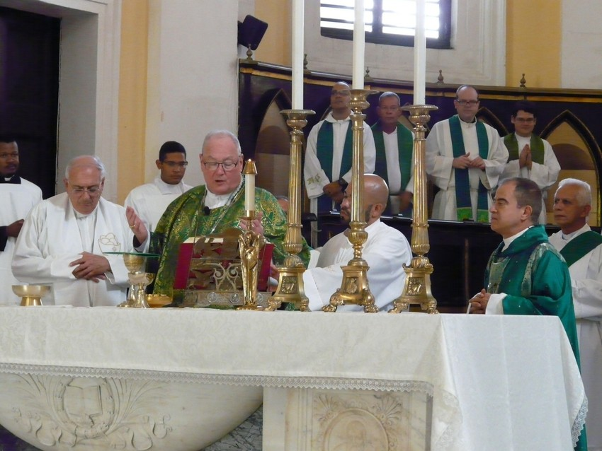 MASS IN SAN JUAN—Cardinal Dolan, second from left, prays during a Mass he celebrated at the Metropolitan Cathedral Basilica of St. John the Baptist in San Juan, Puerto Rico, Oct. 30. At left is Bishop Nicholas DiMarzio of Brooklyn and at right is Archbishop Roberto Gonzalez of San Juan.  Cardinal Dolan and Bishop DiMarzio led a delegation of priests and other church employees from New York to San Juan 40 days after Hurricane Maria devastated the island.