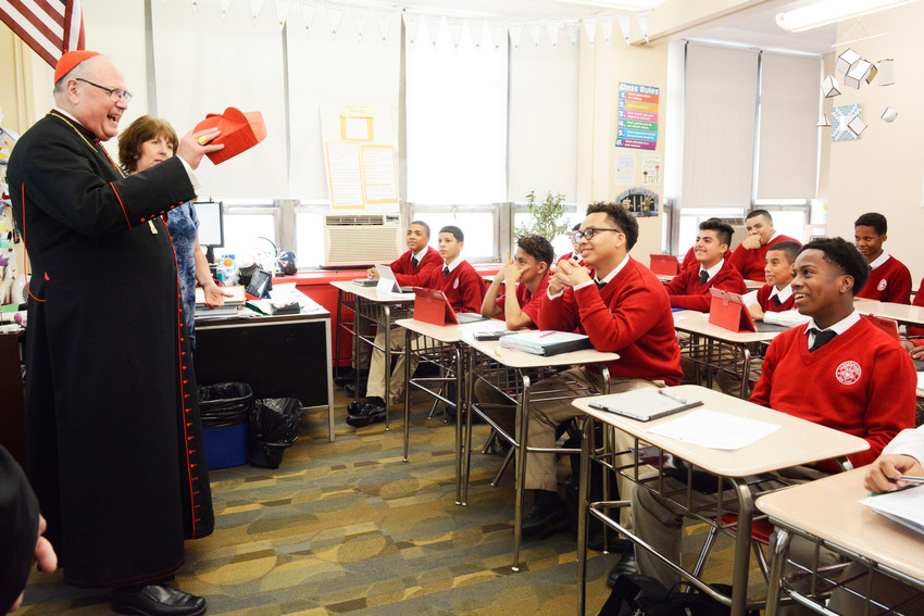 Cardinal Dolan talks to students in Ms. Yvette Masullo's class during his visit to La Salle Academy on All Saints Day Nov. 1. Cardinal Dolan celebrated Mass and toured the school with school president Dr. Catherine L. Guerriero and principal Kerry Conroy. The tour included a stop at St. George Academy, which shares the building with La Salle.