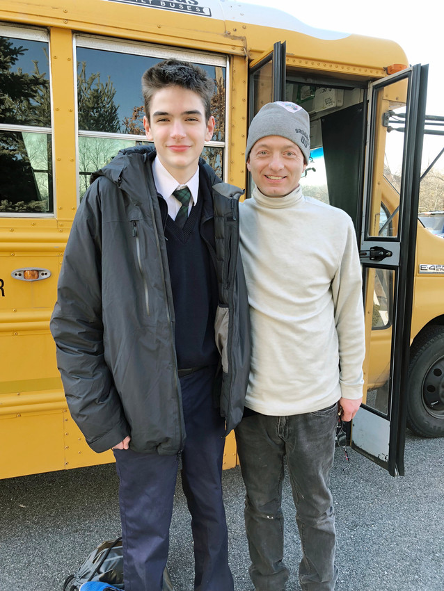 STUDENT ASSISTANT—David Rae, an eighth-grader at St. Patrick's School in Yorktown Heights, stands with his bus driver Anthony Andriani this week. David stepped forward to contact the bus company when Andriani took ill Nov. 28 while driving students home from school. Another driver soon was sent to relieve Andriani and bring the students home safely.