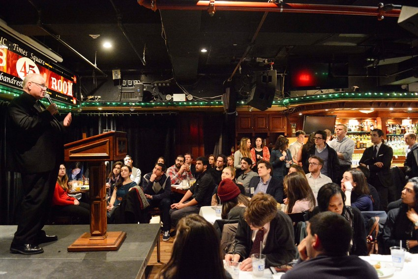 """Cardinal Dolan talks to young adults about Ash Wednesday and Lent during """"Theology on Tap with Cardinal Dolan"""" at Connolly's Pub and Restaurant in Manhattan Feb. 12. The archdiocese's Office of Young Adult Outreach sponsored the event."""