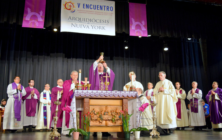 Cardinal Dolan offers the closing Mass at the Archdiocesan Encuentro, a gathering of some 650 Hispanic ministry leaders and parishioners from throughout the archdiocese. The Spanish-language event was held Feb. 24 in the gymnasium of the College of Mount St. Vincent in the Riverdale section of the Bronx. To the cardinal's left is Archbishop Octavio Ruiz Arenas, secretary of the Pontifical Council for Promoting the New Evangelization. To the cardinal's right is Auxiliary Bishop Peter Byrne and, standing next to Bishop Byrne is Auxiliary Bishop Gerald Walsh.