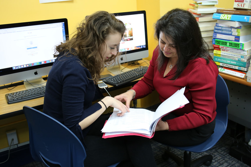 Olivia Halligan, left, and her coach Clara Roman go through college information at the Don Bosco Community Center in Port Chester March 9. Olivia is one of 10 high school students in the Don Bosco Scholars First Gen College Access Program for 2017-2018. Coaches help students complete college, financial aid and scholarship applications. Olivia plans to study biology in college and hopes to become a doctor.