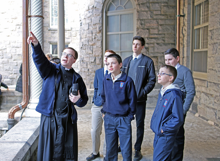 Father Hartley Bancroft, parochial vicar of St. Martin de Porres parish in Poughkeepsie, gives a tour of St. Joseph's Seminary in Dunwoodie as part of an Evening for Vocations March 19. An estimated 150 students, chaperones and priests from schools in the archdiocese participated in the event, which also featured Solemn Evening Prayer with Auxiliary Bishop John O'Hara and an Italian dinner to celebrate the Feast of St. Joseph.