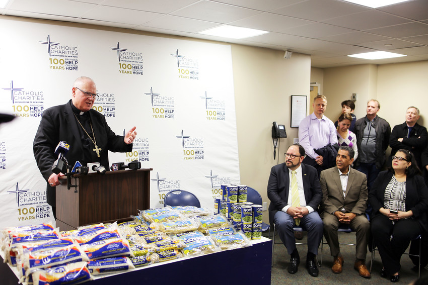 Cardinal Dolan speaks at a Catholic Charities Holy Thursday food distribution event March 29 at Cristo Rey New York High School in East Harlem, where Goya Foods recommitted its support to Catholic Charities by announcing a 300,000-pound food donation to Charities' pantries to help New Yorkers in need.