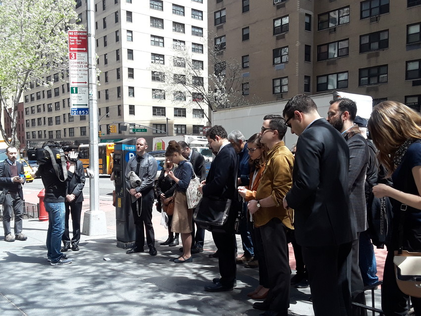 ADVOCATES FOR ALFIE—Colin Nykaza, director of young adult outreach for the archdiocese, in gray shirt and tie at far left, leads the Rosary outside the UK Mission to the United Nations April 26 on behalf of English toddler Alfie Evans. A Mass at Holy Family Church near the United Nations preceded the prayer vigil. Edward Mechmann, director of public policy for the archdiocese, is pictured behind Nykaza.