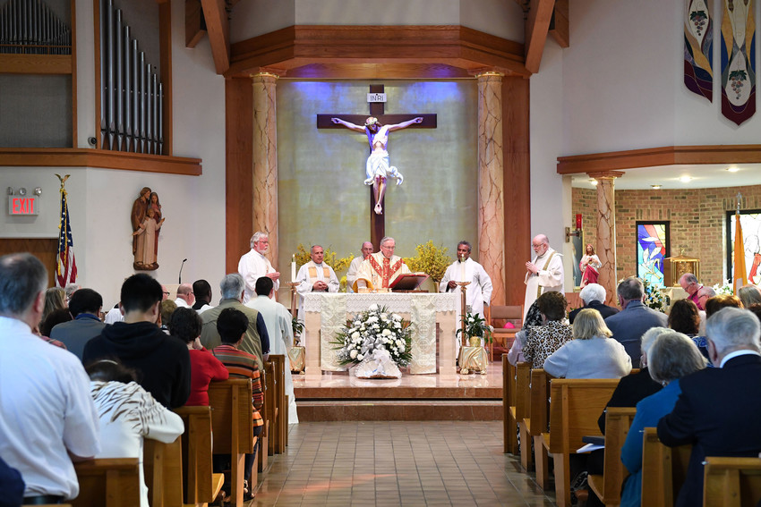 Msgr. Peter Finn, dean of Staten Island and pastor of Blessed Sacrament parish, offers Corpus Christi Mass June 3 at Holy Family Church on Staten Island.
