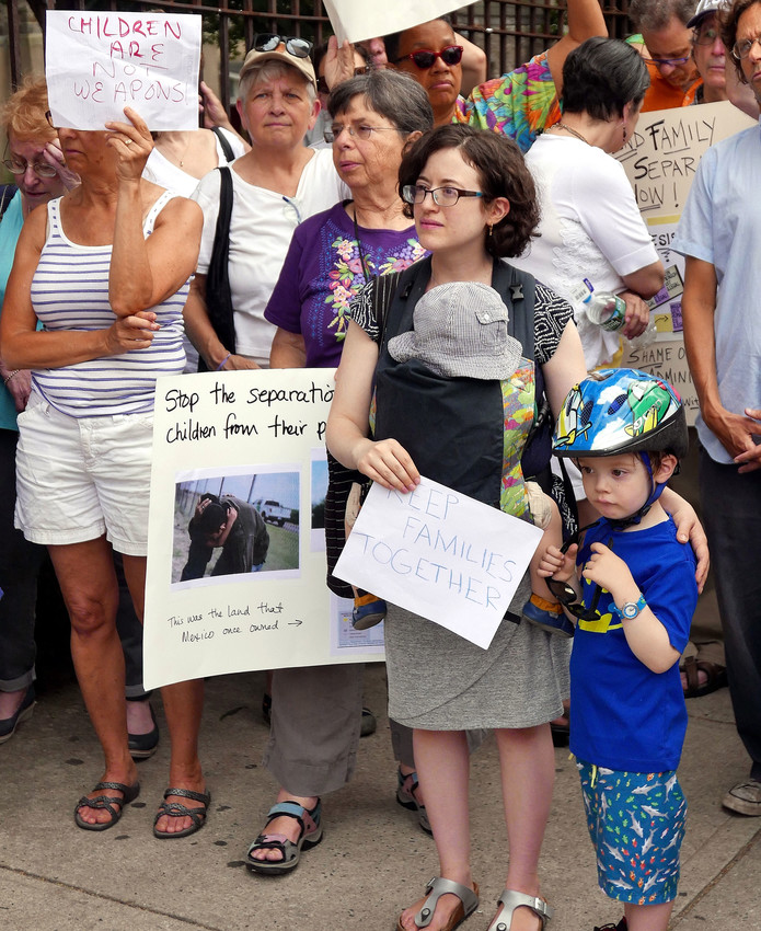 """Arielle Rubenstern and her children, Raphael, 4, and Elijah, 1, participated in a vigil in the Bronx June 18 calling for an end to the separation of children from their parents at the U.S. border with Mexico. The event was co-sponsored by the Sisters of Charity of New York and North Bronx Racial Justice. """"As women religious, as Christians, it is our moral duty to speak for the children who are being separated from their parents. This policy is devastating and dangerous on countless levels and it must end,"""" said Sister Jane Iannucelli, S.C., president of the Sisters of Charity."""