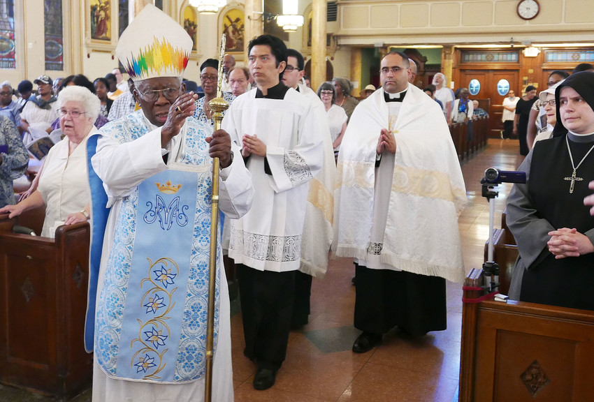 Cardinal Francis Arinze, prefect emeritus of the Vatican Congregation for the Divine Worship and Discipline of the Sacraments, celebrated the solemn Mass for the Feast of Our Lady of Mount Carmel at the Pontifical Shrine of Our Lady of Mount Carmel in East Harlem July 16.