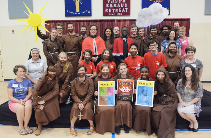 """PERFORMERS' PORTRAIT—Above, teens in costume and adults working behind the scenes on """"Solanus: Blessed in America, The Story of Blessed Solanus Casey, O.F.M. Cap."""" take a group photo July 30. The musical, written by Father Erik Lenhart, O.F.M. Cap., is being performed Friday, Aug. 3, in St. Genesius Gymnasium on the Catholic Youth & Family Ministries campus in Garrison."""