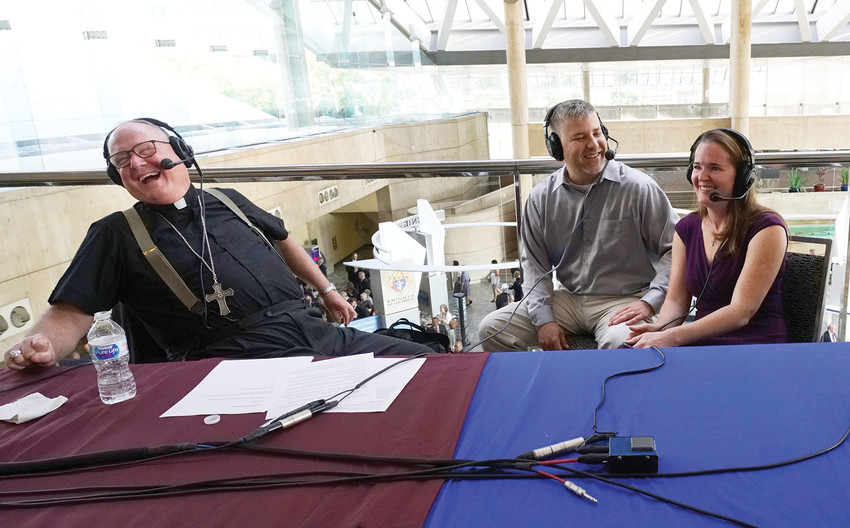Cardinal Dolan laughs Aug. 7 while interviewing Ryan and Elizabeth Young of St. Martin de Porres parish in Poughkeepsie at the Knights of Columbus convention in Baltimore during his weekly live radio show, hosted by the Catholic Channel on the Sirius XM network.