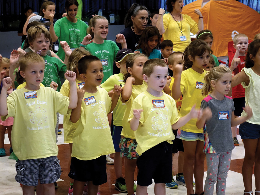 Children sing a song during St. Denis Vacation Bible School in Hopewell Junction Aug. 2. The four-day school, held in the St. Denis Parish Center, featured teachings of the Catholic faith, outdoor games and crafts.