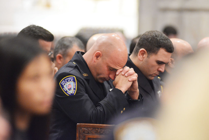 Port Authority police officers pray during the special Mass.
