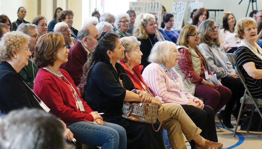 Participants listen attentively.
