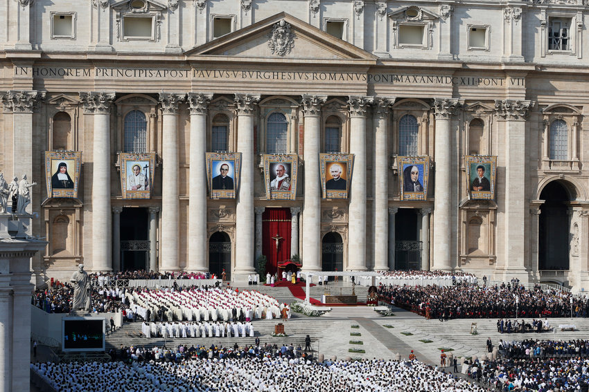 Banners of new saints hang from the facade of St. Peter's Basilica before the canonization Mass for seven new saints celebrated by Pope Francis in St. Peter's Square at the Vatican Oct. 14.