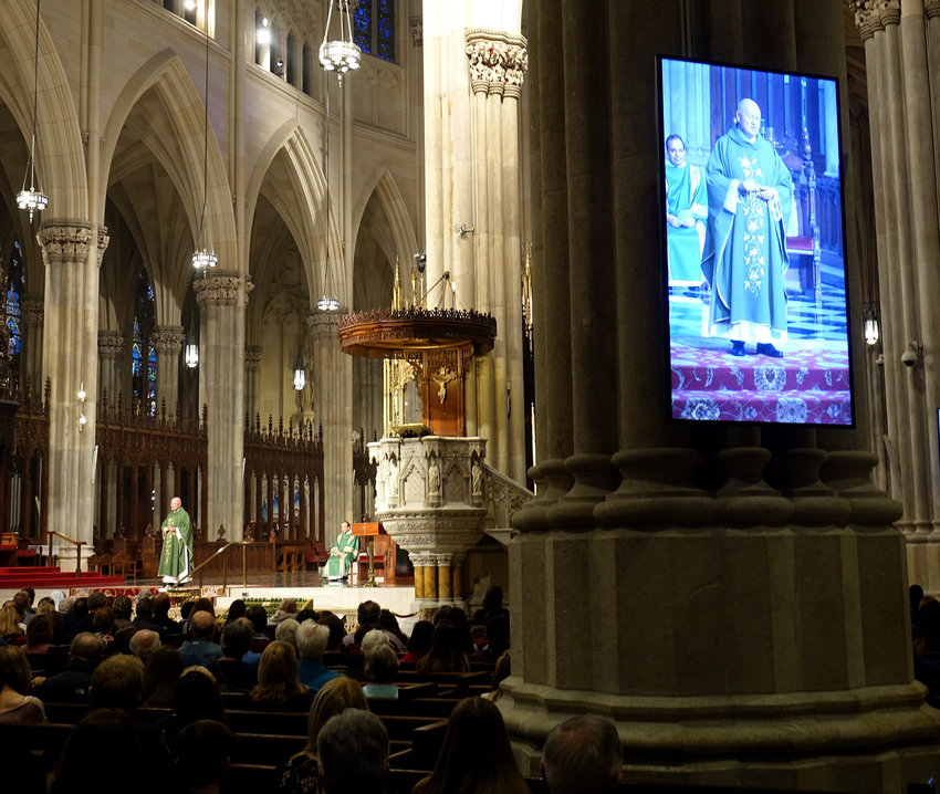CELEBRATION—Msgr. Robert Ritchie, rector of St. Patrick's Cathedral, addresses the faithful at the 10:15 a.m. Mass he offered there on Oct. 14. Seated behind him is Deacon Samir Mobarek, a permanent deacon of St. Augustine parish, New City.