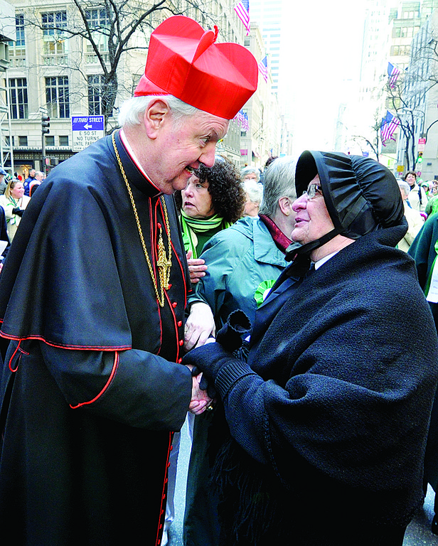 HONORING THE PAST—Cardinal Egan, then the Archbishop of New York, talks with Sister Dominica Rocchio, S.C., wearing historic habit, at 2009 St. Patrick's Day Parade, which was dedicated to the Sisters of Charity for their 200 years of service.
