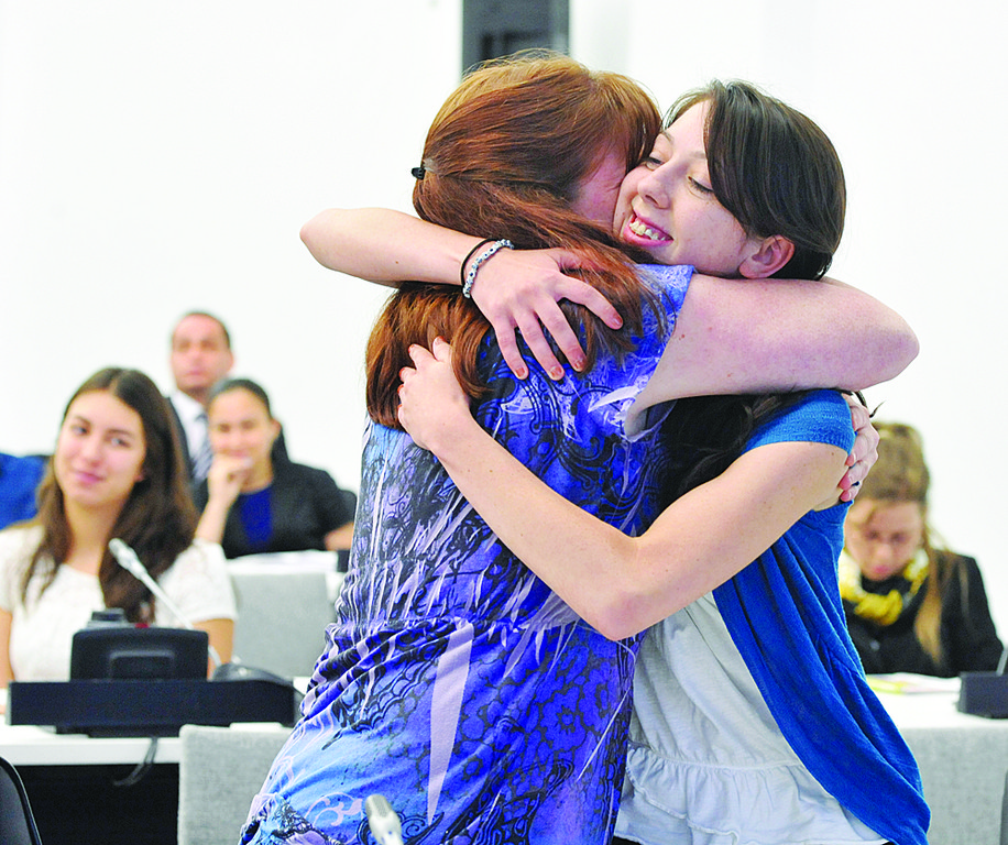 SPIRITED-Samantha Lindsay, winner of a trip to World Youth Day in Madrid, is hugged by her aunt, Bernadette Cocharelli. Samantha is a student at Preston High School in the Bronx.