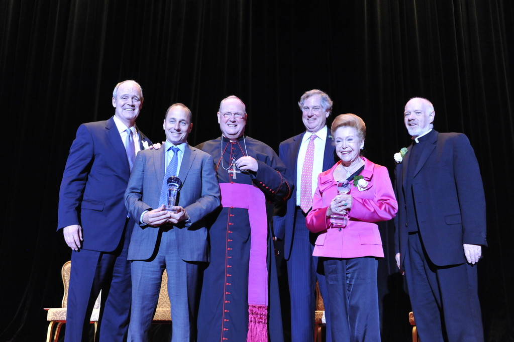 CHAMPS—Yankees general manager Brian Cashman, second from left, and author Mary Higgins Clark, second from right, hold awards they received from Archbishop Dolan during CYO Club of Champions Tribute. Also, from left, are Alec McCauley, CYO director; Christopher Gallagher, president of the CYO board of directors; and Msgr. Kevin Sullivan, executive director of Catholic Charities.