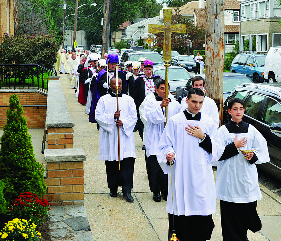 JOYFUL—Long procession moves toward St. Vito's Church in Mamaroneck before the closing Mass of the centennial year.