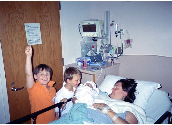 "FAMILY MOMENT—Alessandra Rose and her sons, Harry and Charlie, welcome their sister Marguerite into the world in 2005. The infant, who had Trisomy 13, lived for four hours. ""I wanted this baby to have an opportunity at life, and I wanted my boys to have an opportunity to love her,"" Mrs. Rose said."