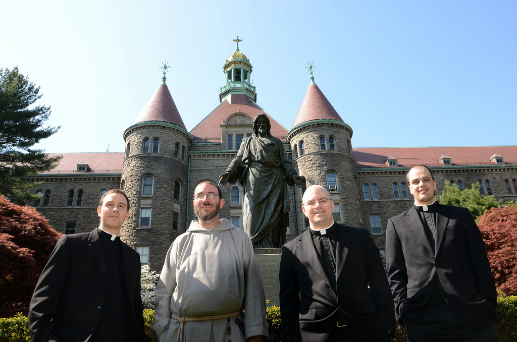 GRADUATES—At St. Joseph's Seminary, Dunwoodie, are Fathers Patrick D'Arcy, John Paul Ouellette, C.F.R., Chad Grennan and Ben Weber.