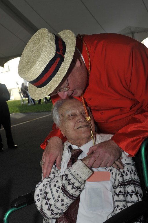 Cardinal Dolan greets Adam Weslowski, a 99-year-old parishioner, at a reception after the Mass.