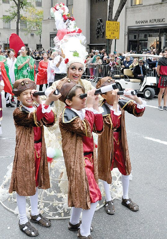 Young voyagers, survey the parade route on Fifth Avenue.